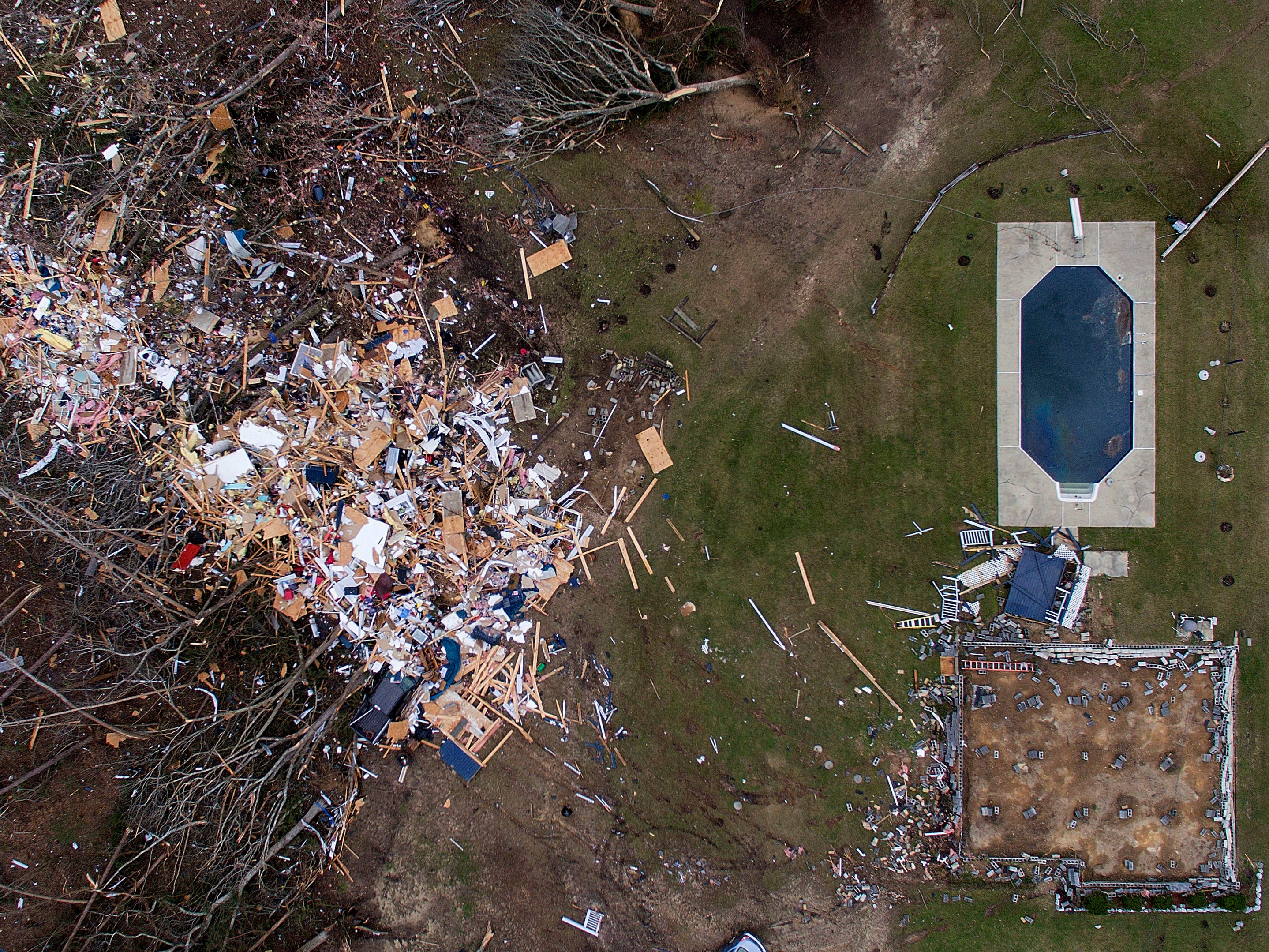 Debris from a home litters a yard the day after a tornado blew it off its foundation in Beauregard, Ala., Monday, March 4, 2019.