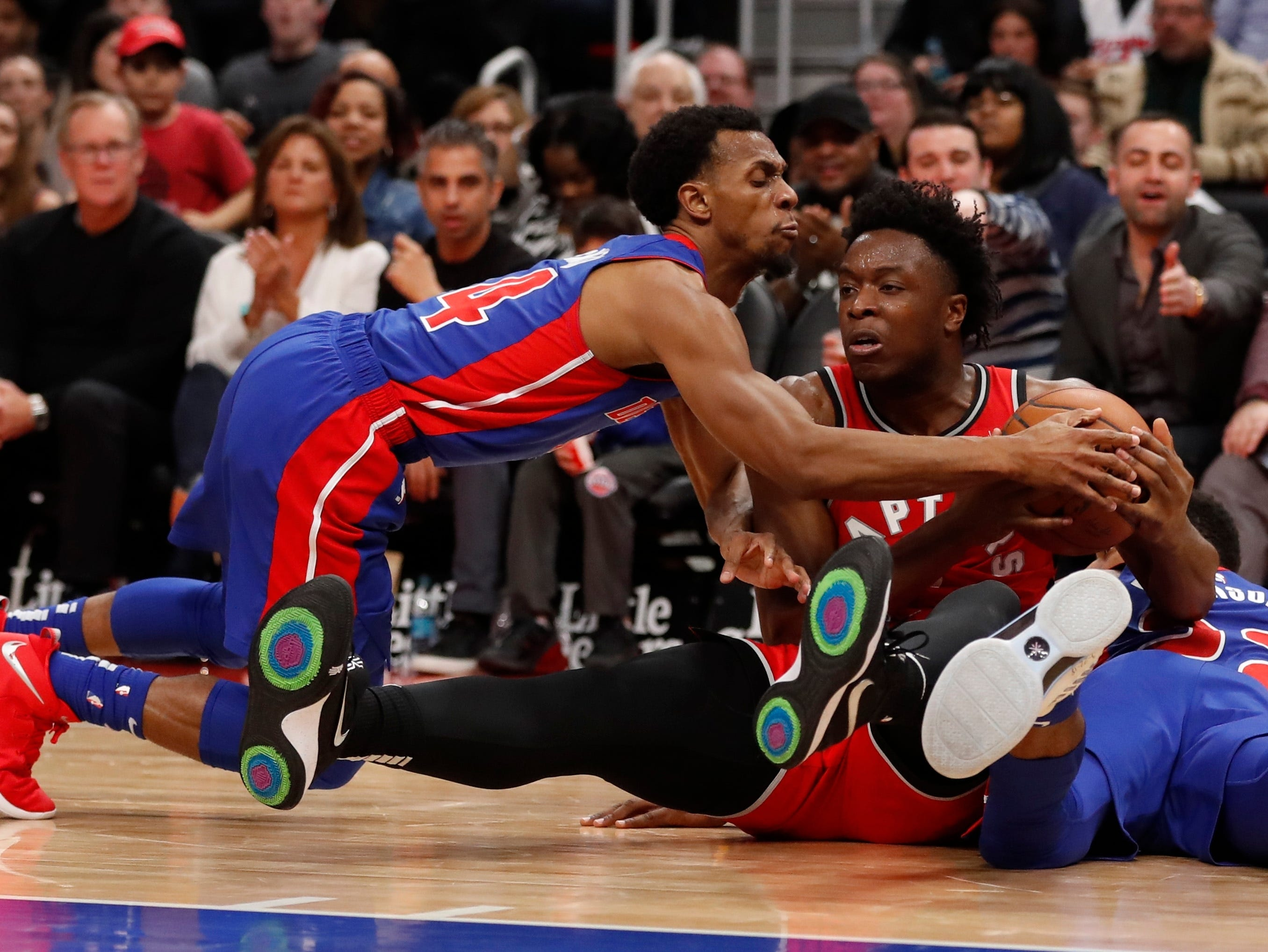 Detroit Pistons guard Ish Smith, left, and Toronto Raptors forward OG Anunoby chase the loose ball during the second half of an NBA basketball game, Sunday, March 3, 2019, in Detroit. Detroit defeated Toronto 112-107 in overtime.