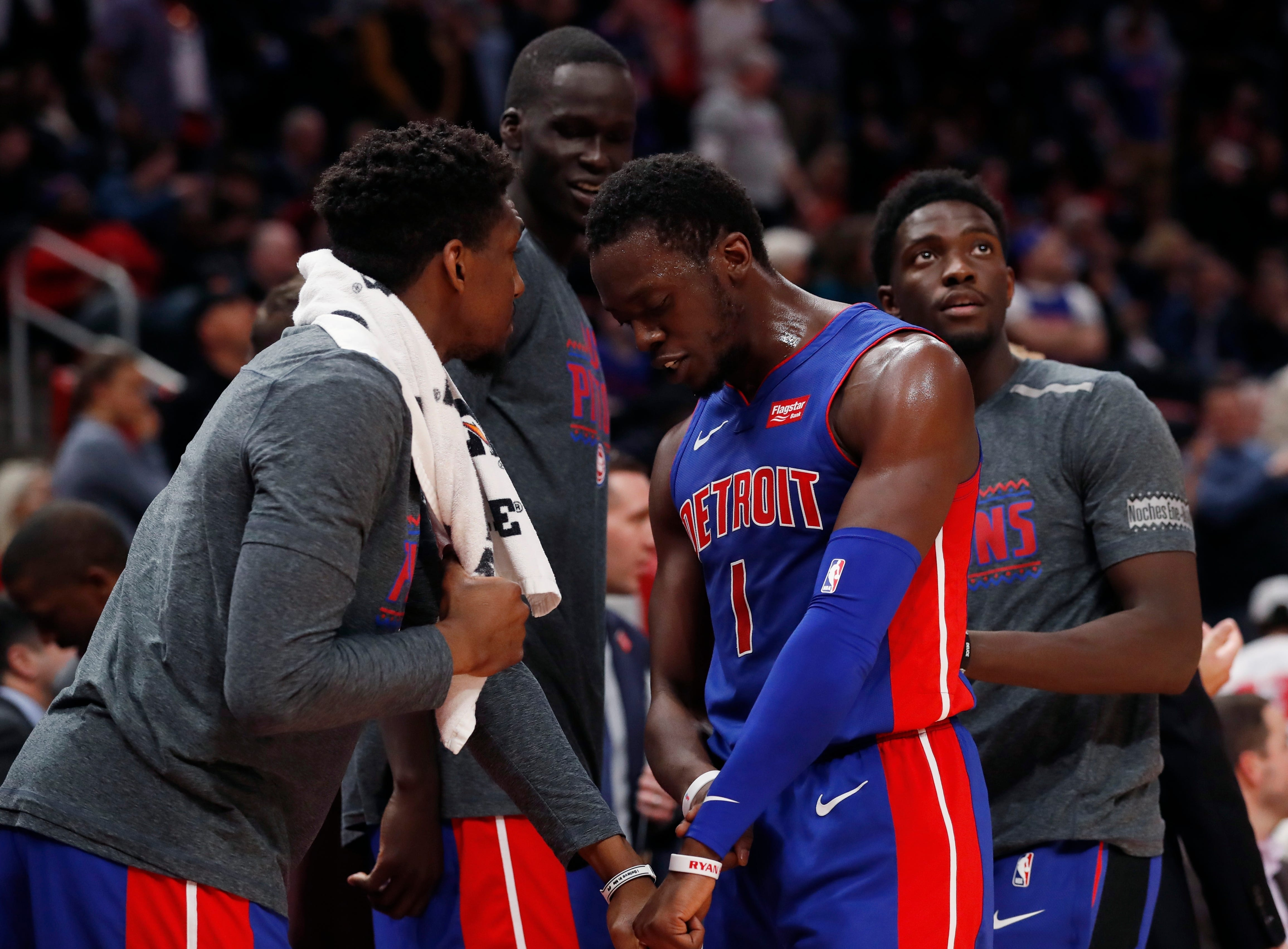 Detroit Pistons guard Langston Galloway, left, greets guard Reggie Jackson during the closing seconds of overtime.