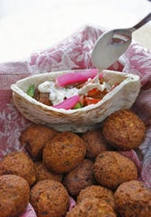Falafels are the balls made with chickpeas and the completed sandwich made with pita bread. (J.B. Forbes/St. Louis Post-Dispatch/TNS)