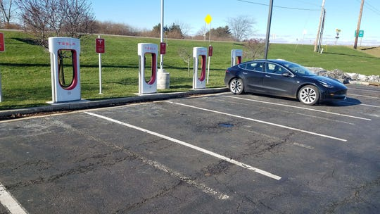 Henry Payne parked his Tesla Model 3 at a Tesla Supercharger in Marshall, Michigan, to load up on electrons for his return home to Oakland County.