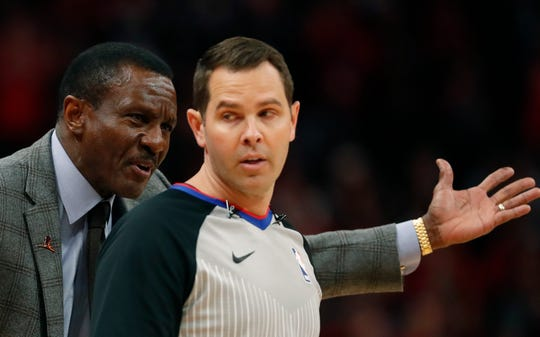 Detroit Pistons head coach Dwane Casey disputes a call with referee Brian Forte during the second half.