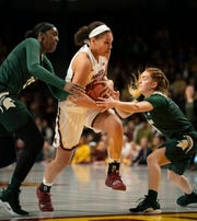 Minnesota's Destiny Pitts (center), a Detroit Country Day product, scored 26 in the Gophers' victory Sunday over Michigan State.