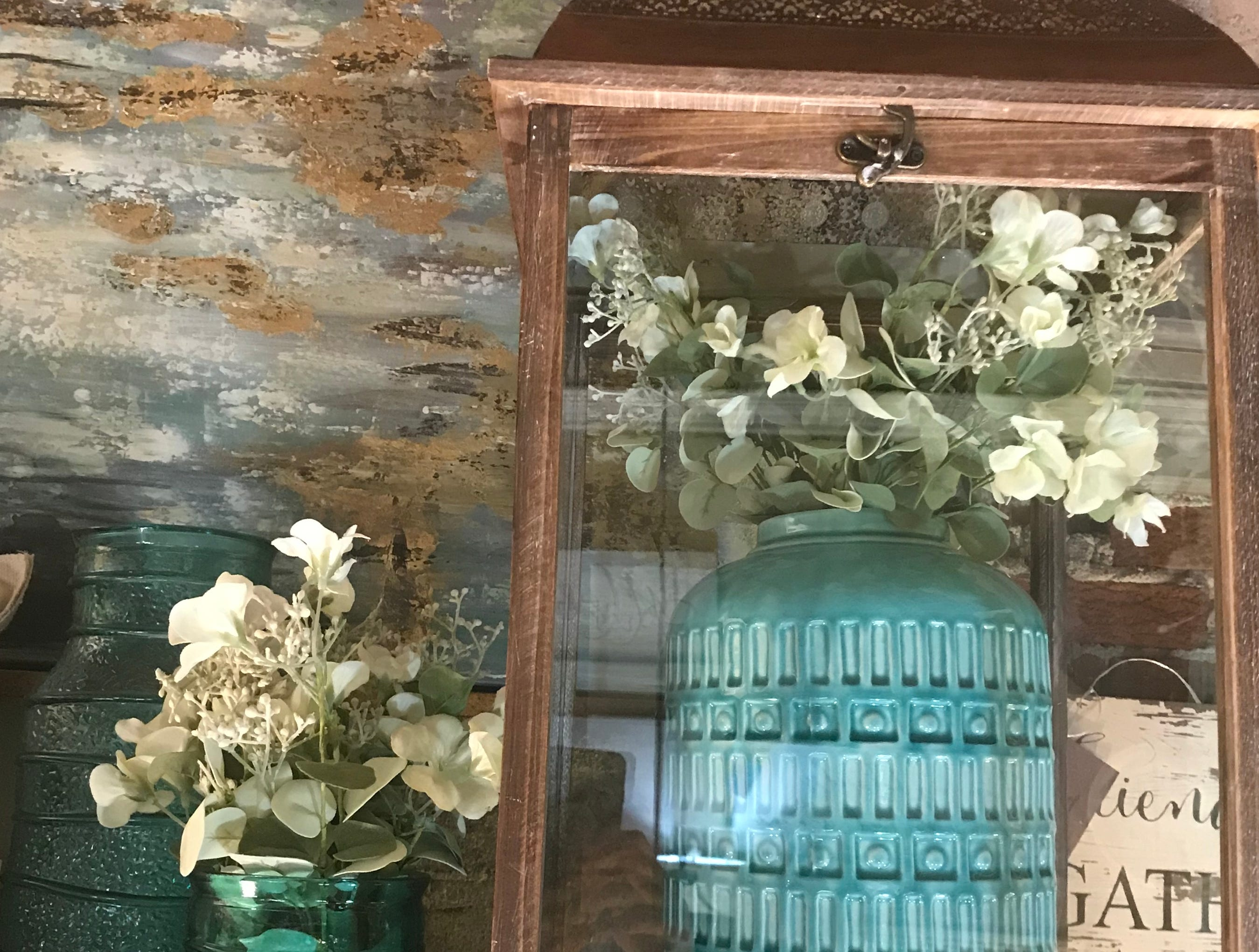 At Grand Trunke Home in South Lyon, owner Susan Stowe says flexible finds like these jars in a wood crate that she filled with dried flowers can change with the seasons for a different view in your favorite room. These staple pieces can go on a windowsill or a mantel.