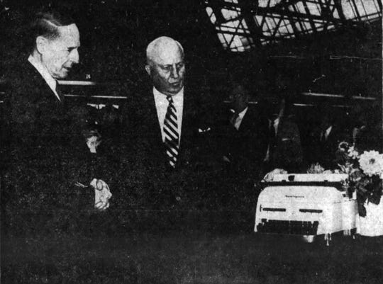 James H. Rand, president of Remington Rand, left, and Gen. Douglas MacArthur, chairman of the company's board, with the 15 millionth typewriter manufactured by the company.