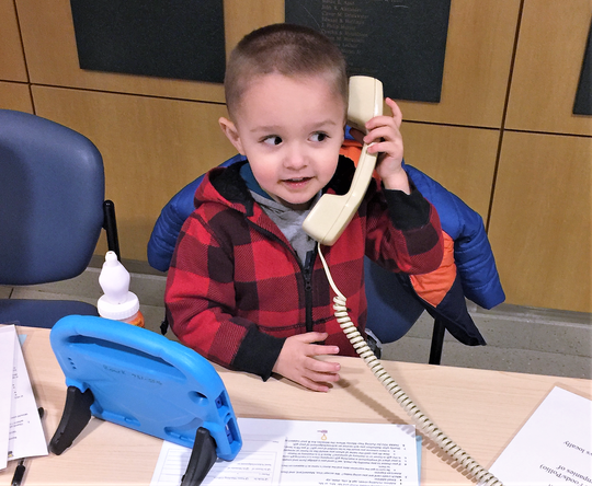 E.J. Roark pitches in answering phones during the 2018 Children's Miracle Network Radiothon at Arnot Ogden Medical Center.