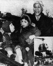 """From left, 2-year-old Bradley Buell and 4-year-old Cheryl McLane meet """"Aunt Jemima,"""" who arrived in Elmira by helicopter in 1955."""