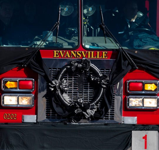 Engine 1 is adorned with a black wreath as it is driven to the entombment of Pvt. Robert Doerr, a firefighter with the Evansville Fire Department, Monday afternoon. Engine 1 was the truck Doerr drove in his duties with Station 1. Doerr was shot and killed in front of his North Side Evansville home last week. The investigation into the homicide is ongoing.