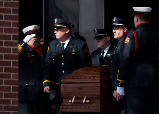 Pallbearers carry the remains of Pvt. Robert Doerr, a firefighter with the Evansville Fire Department, to a hearse after his funeral at the Christian Fellowship Church Monday afternoon. Doerr was shot and killed in front of his North Side Evansville home last week. The investigation into the homicide is ongoing.
