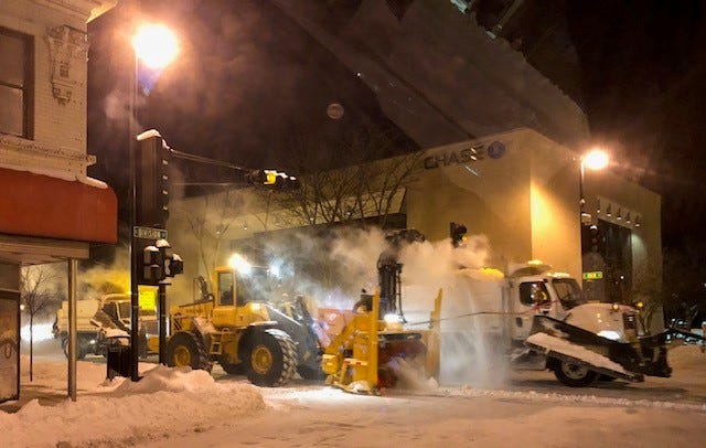 Fond du Lac crews remove snow from downtown at night while the city sleeps.