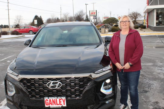 Teresa Slosser, of Clyde, stands next to her 2019 Hyundai Santa Fe.