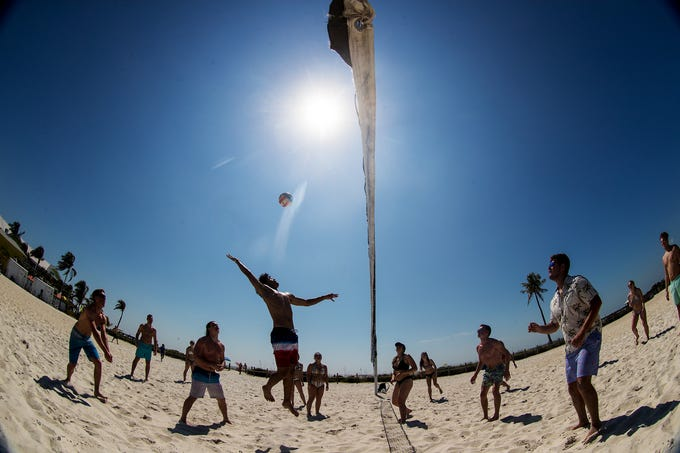 Andre Kimble. a student at Ohio Northern University goes up for shot while playing volleyball with fellow spring breakers at Crescent Park on Fort Myers Beach on Monday 3/4/2019. Spring Breakers are starting to flock to  Southwest Florida.