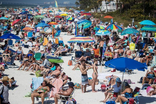 Visitors take in the sun at Fort Myers Beach on Monday 2/4/2019. The locale is listed among one of the worst spring break destinations by GOBankingRates.com.