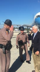 A trooper from the Florida Highway Patrol's Fort Myers' headquarters offers Vice President Mike Pence a salute as he prepares to leave Southwest Florida International Airport on Sunday afternoon. Pence spent the weekend on Sanibel Island.