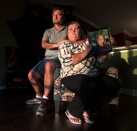 Charles and Peggy Mandeville sit inside their daughter's home Tuesday, February 19, 2019. They are the parents of Jill Mandeville, pictured, who died October 25, 2018 after an unlicensed juvenile driving a pickup ran through a stop sign, killing her and leaving his two passengers seriously injured. Jill was 33.