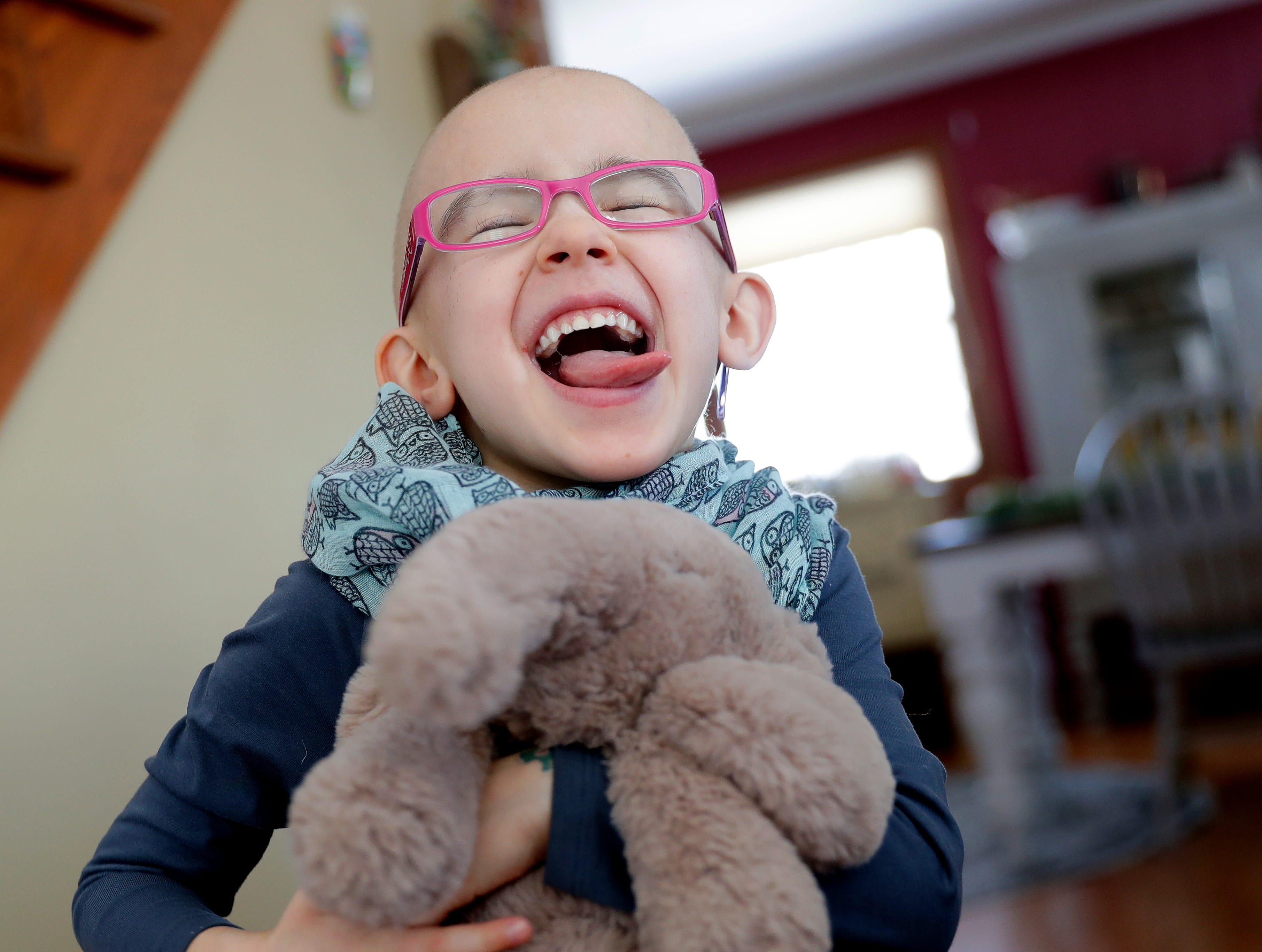 Lily Wertel, 6, makes a silly face while in the living room of her family's home on March 2, 2019, in Wrightstown, Wis. A benefit for Lily, who has cancer, is scheduled for May 19, 2019, at the Riverside Ballroom in Green Bay, Wis.