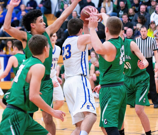Oconto's Zach Sherman tries to make a pass through the tight defense of Coleman players Payton Nelson, Simon Maedke, Nick Teteak and Preston Gusick in their game on Feb. 26.