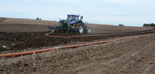 Manure is spread on a farm field during the Door-Kewaunee Watershed Demonstration Farms Network's Spring Field Day at Heims Hillcrest Dairy, in Casco, Wis., on May 1, 2018.