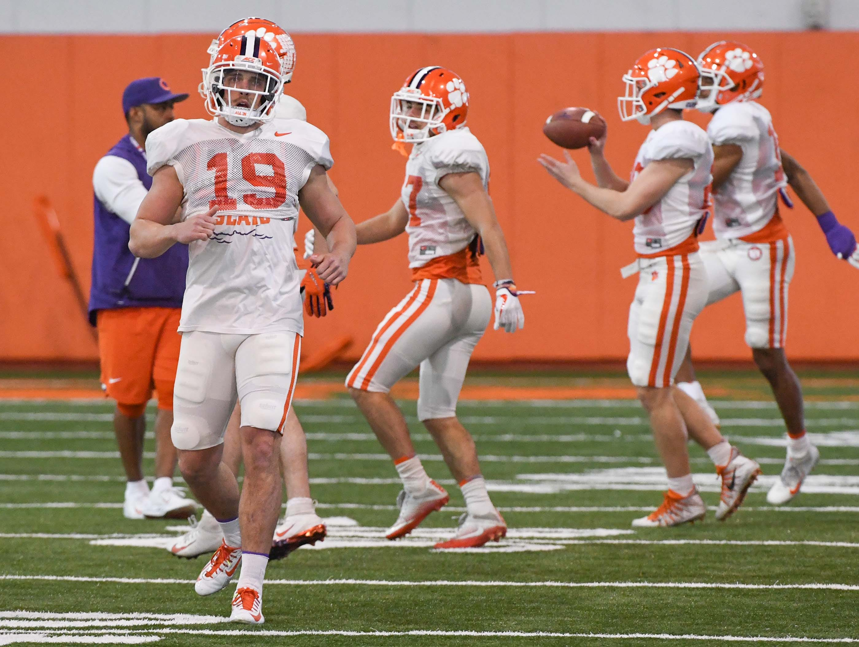 Clemson defensive back Tanner Muse (19) runs during practice at the Poe Indoor Facility in Clemson Monday.