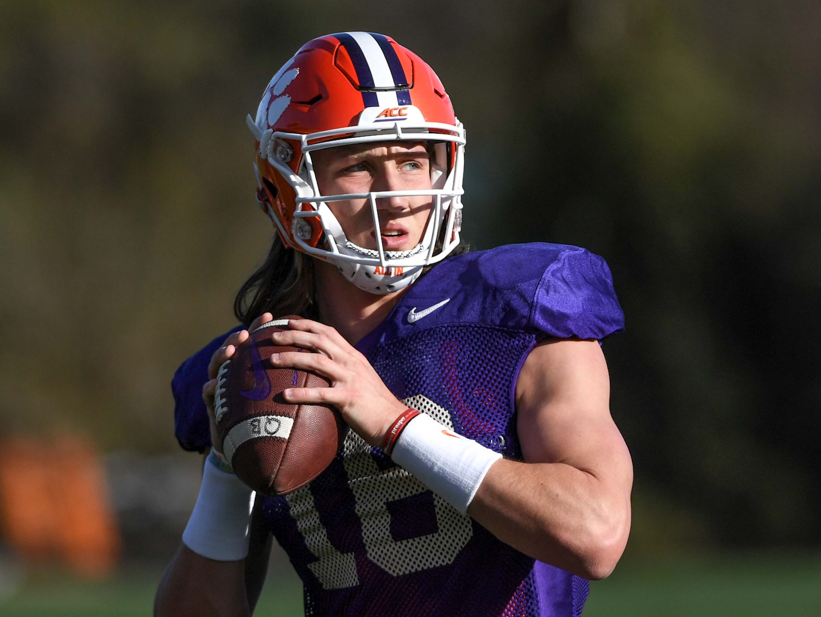 Clemson quarterback Trevor Lawrence (16) gets ready to pass during practice at the Poe Indoor Facility in Clemson Monday.