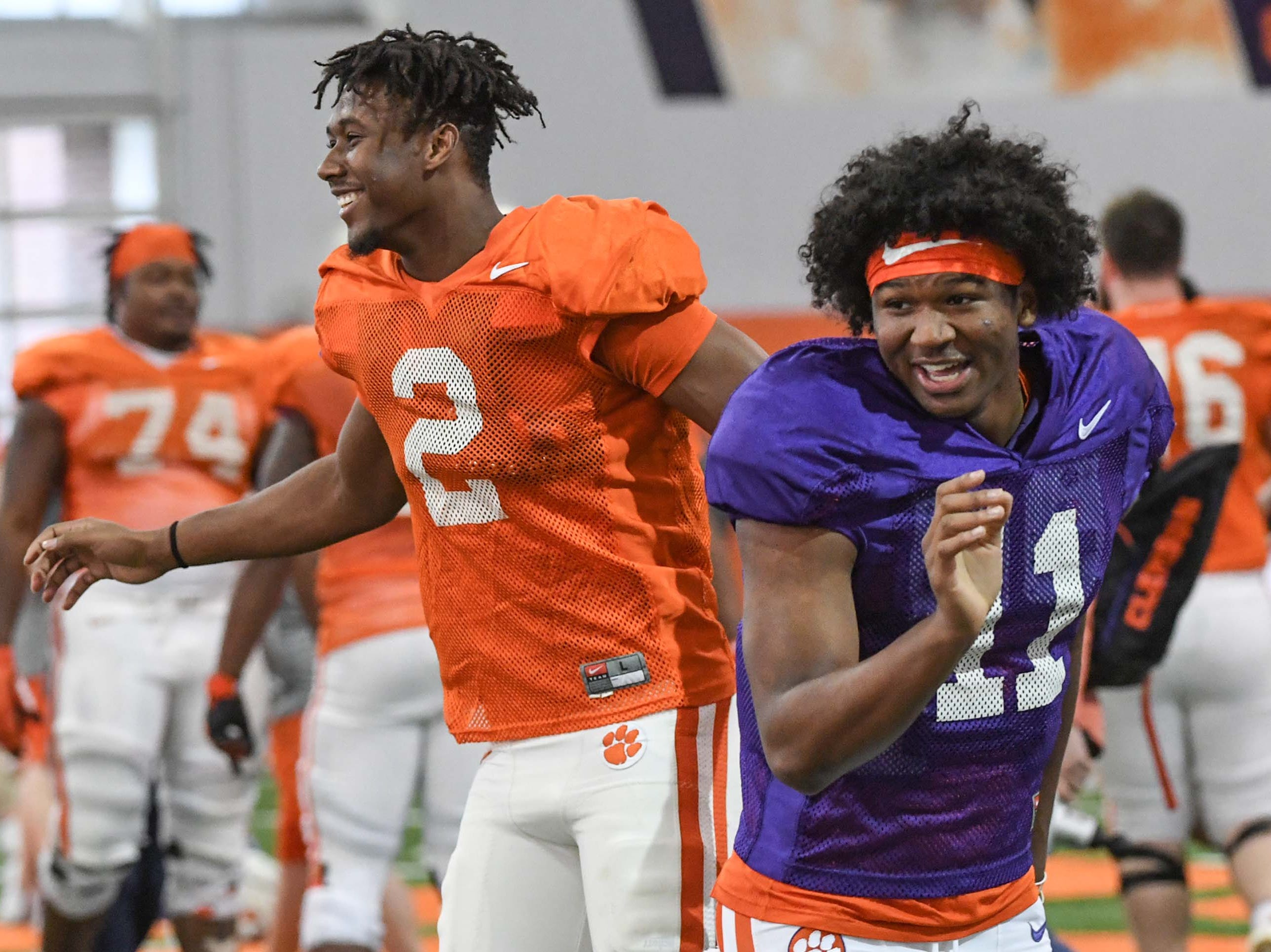 Clemson wide receiver Frank Ladson, Jr. (2) greets quarterback Taisun Phommachanh(11) during practice at the Poe Indoor Facility in Clemson Monday.