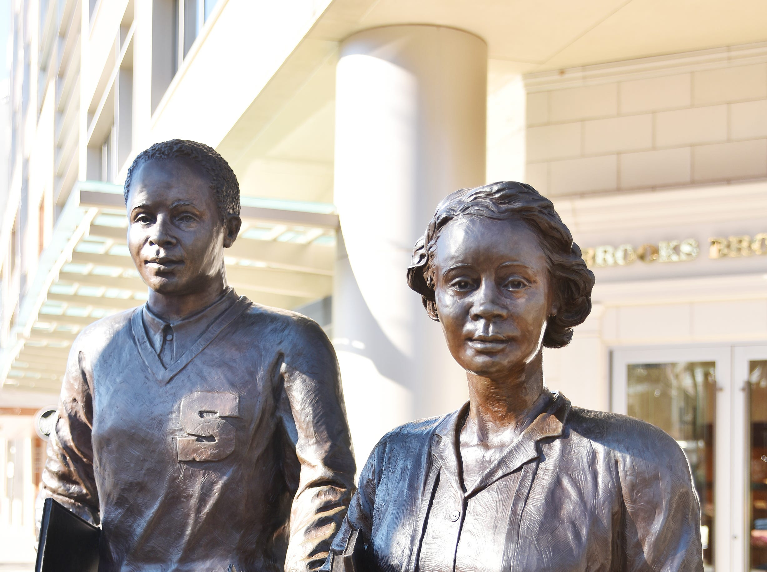 Sterling High School Students by Mariah Kirby-Smith.  Installed in front of the former Woolworth building where Sterling students held sit-ins and protests during the civil rights movement, this bronze sculpture depicts two students proudly descending the steps of Sterling High School.