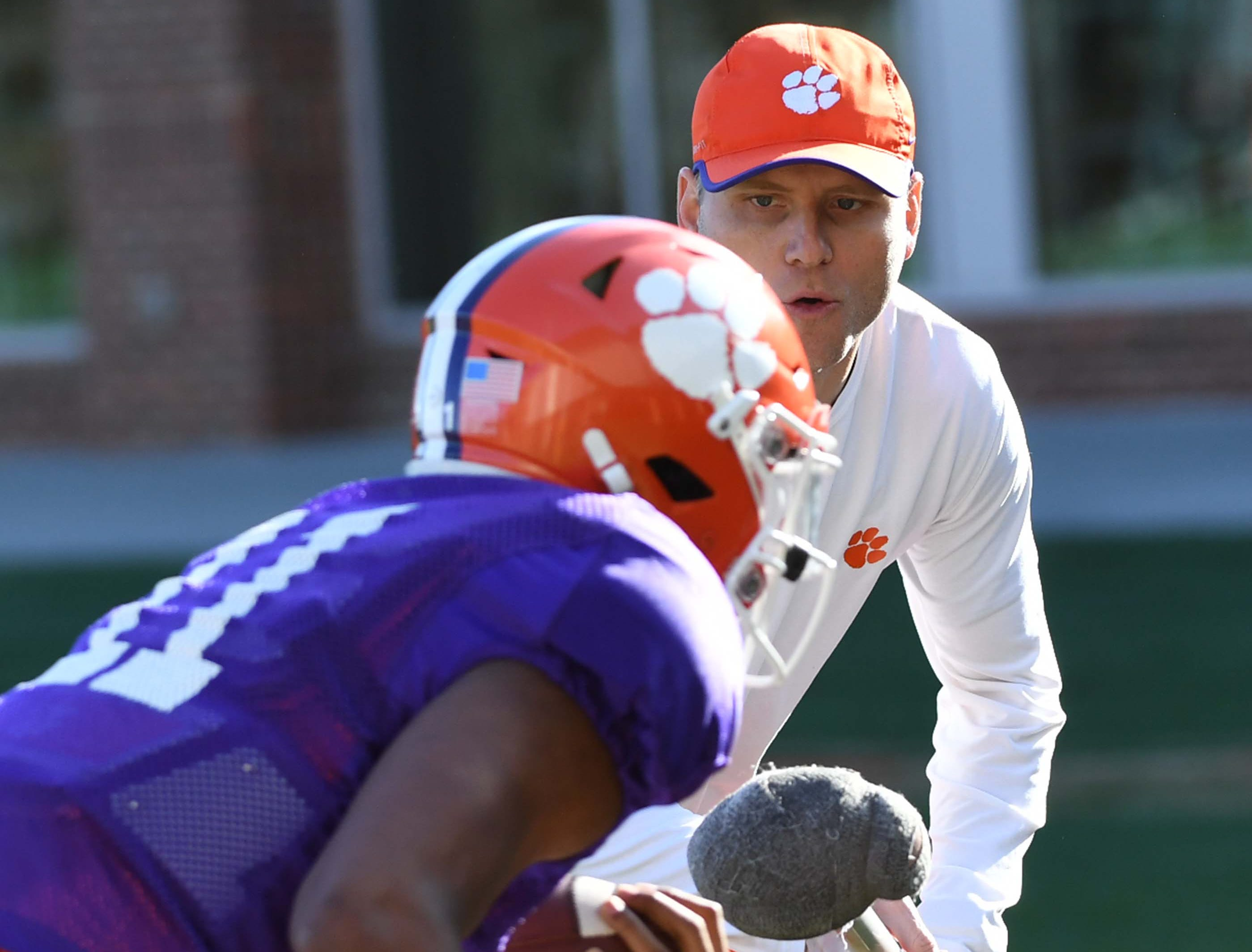 Clemson quarterbacks coach Brandon Streeter works with quarterback Taisun Phommachanh(11) during practice at the Poe Indoor Facility in Clemson Monday.