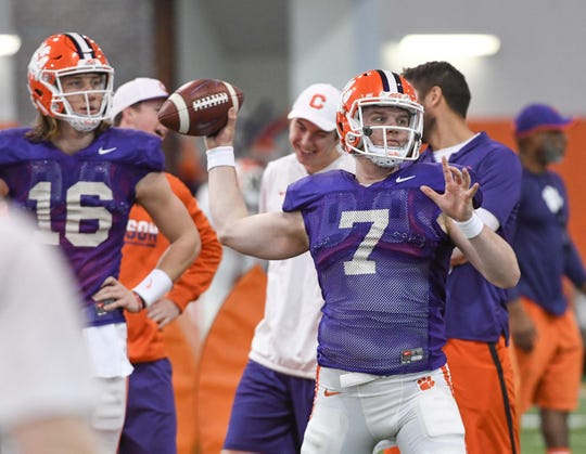 Clemson quarterback Chase Brice (7)  passes during practice at the Poe Indoor Facility in Clemson Monday.