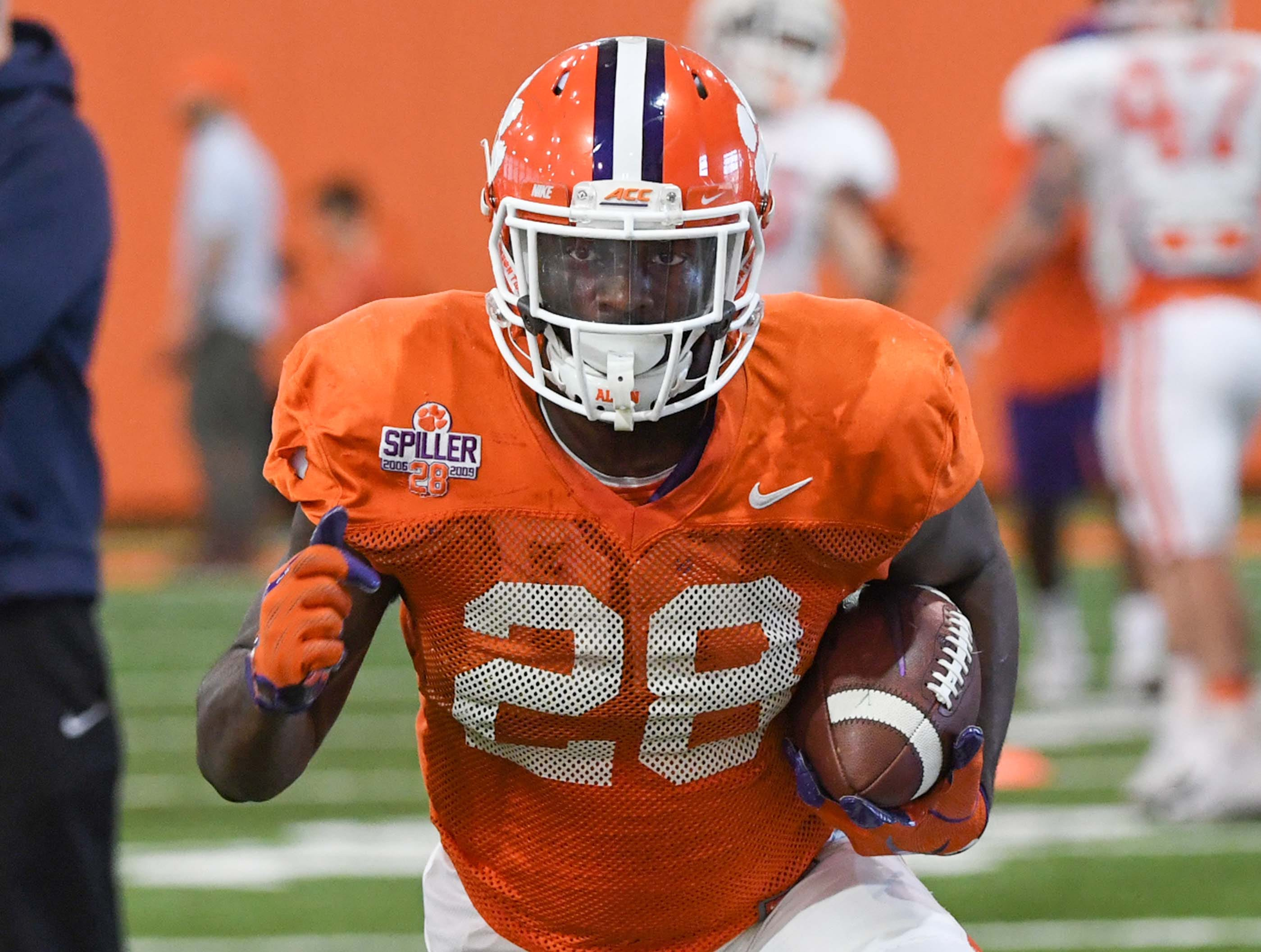 Clemson running back Tavien Feaster (28) runs during practice at the Poe Indoor Facility in Clemson Monday.