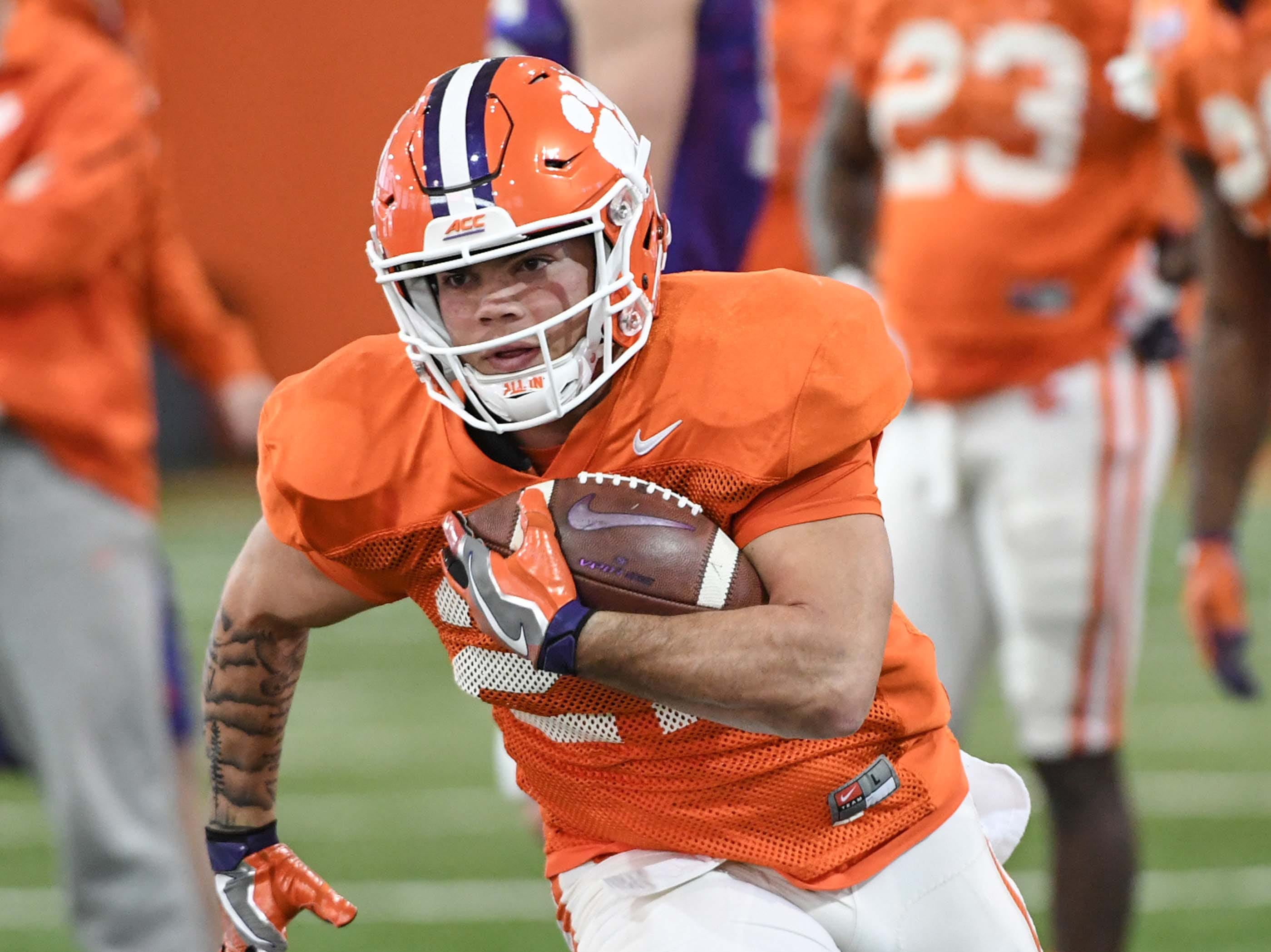 Clemson running back Ty Lucas(27) runs during practice at the Poe Indoor Facility in Clemson Monday.