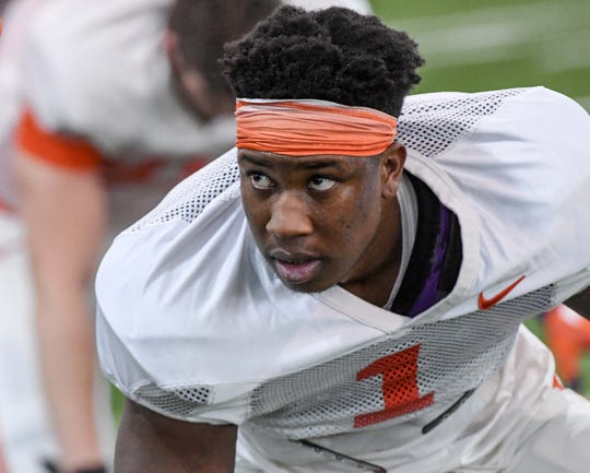 Clemson defensive end K.J. Henry(1) stretches during practice at the Poe Indoor Facility in Clemson Monday.