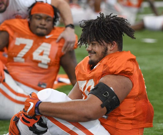 Clemson offensive lineman Jackson Carman (79) stretches during practice at the Poe Indoor Facility in Clemson Monday.