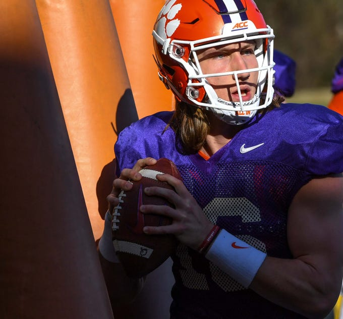 Clemson quarterback Trevor Lawrence (16) moves around in a footwork drill during practice at the Poe Indoor Facility in Clemson Monday.