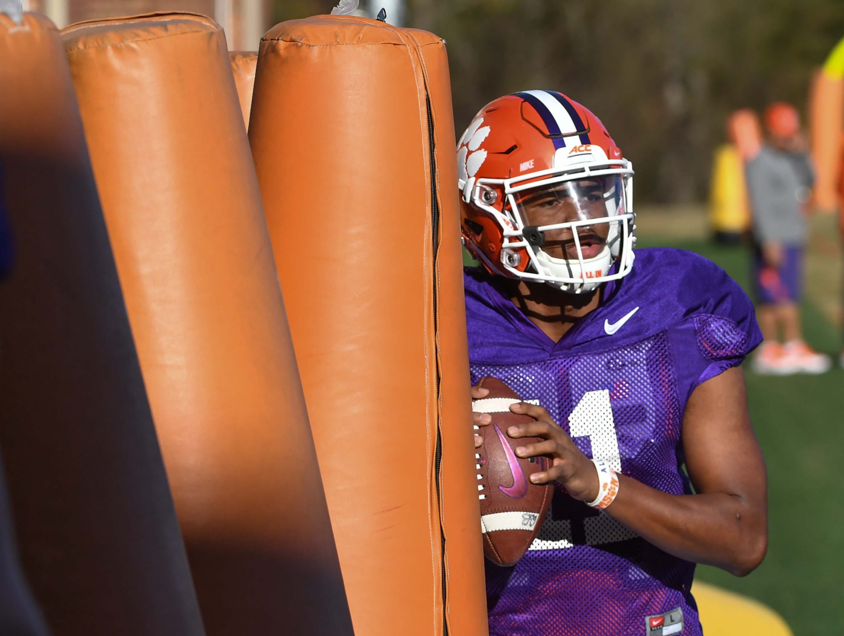 Clemson quarterback Taisun Phommachanh(11) moves around in a footwork drill during practice at the Poe Indoor Facility in Clemson Monday.