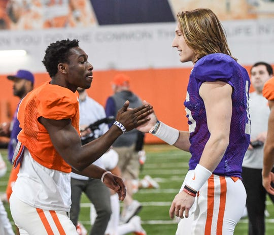 Clemson Derion Kendrick(1) greets quarterback Trevor Lawrence (16) during practice at the Poe Indoor Facility in Clemson Monday.