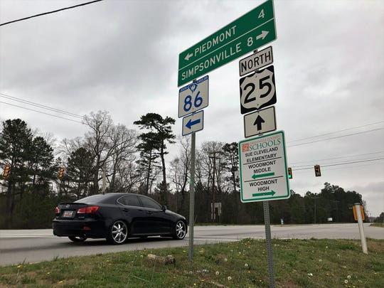 Vehicles pass through the intersection of Augusta Road and Sandy Springs Road outside Piedmont in southern Greenville County on Sunday, March 3, 2019. Developers plan to build and market the South Greenville Enterprise Park nearby.