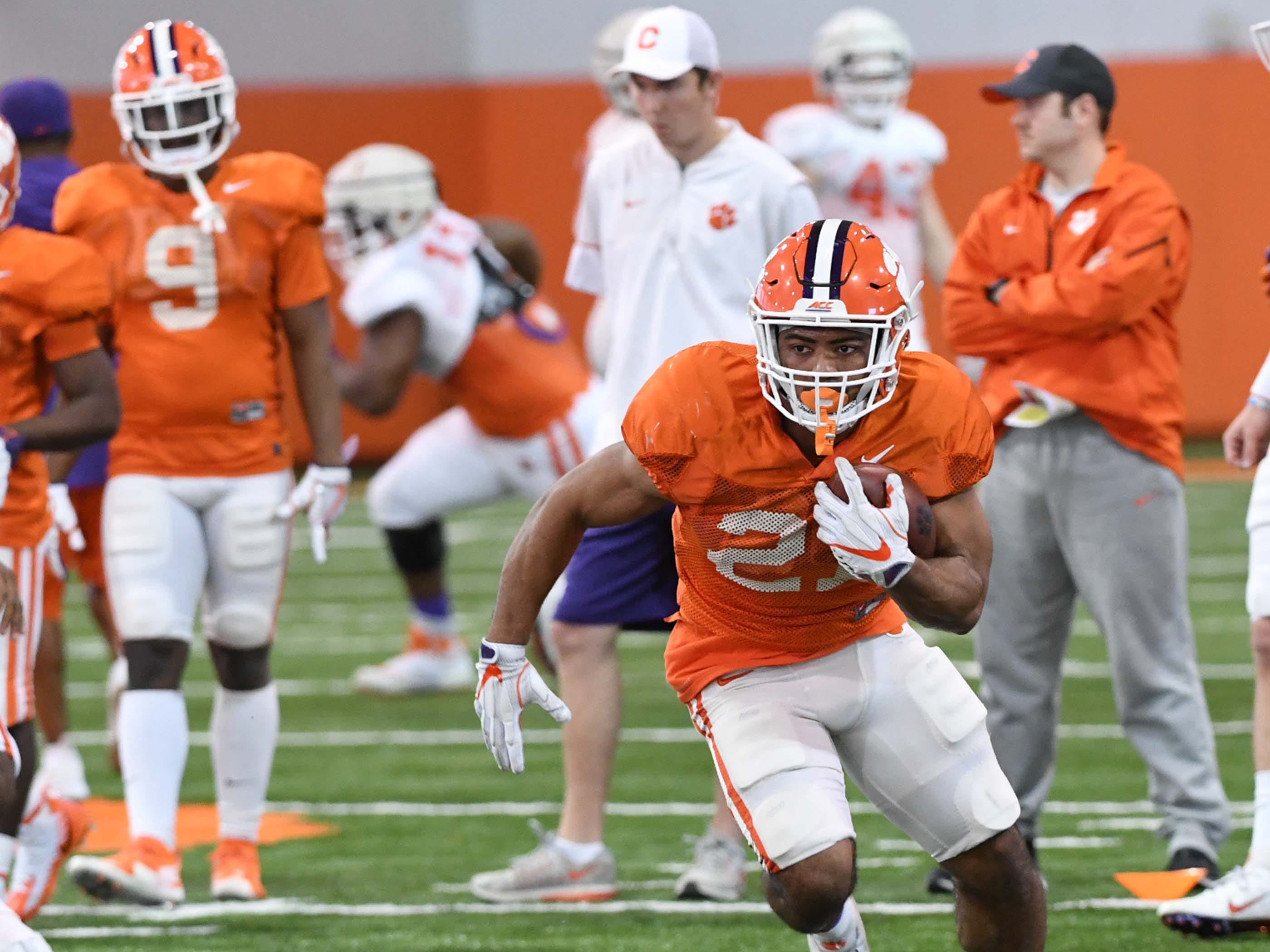 Clemson running back Darien Rencher (21) runs during practice at the Poe Indoor Facility in Clemson Monday.