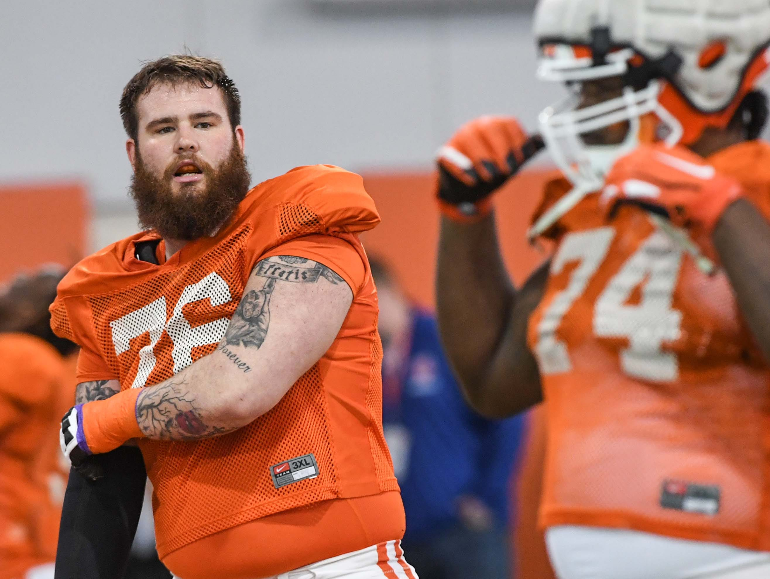 Clemson offensive lineman Sean Pollard (76) stretches during practice at the Poe Indoor Facility in Clemson Monday.
