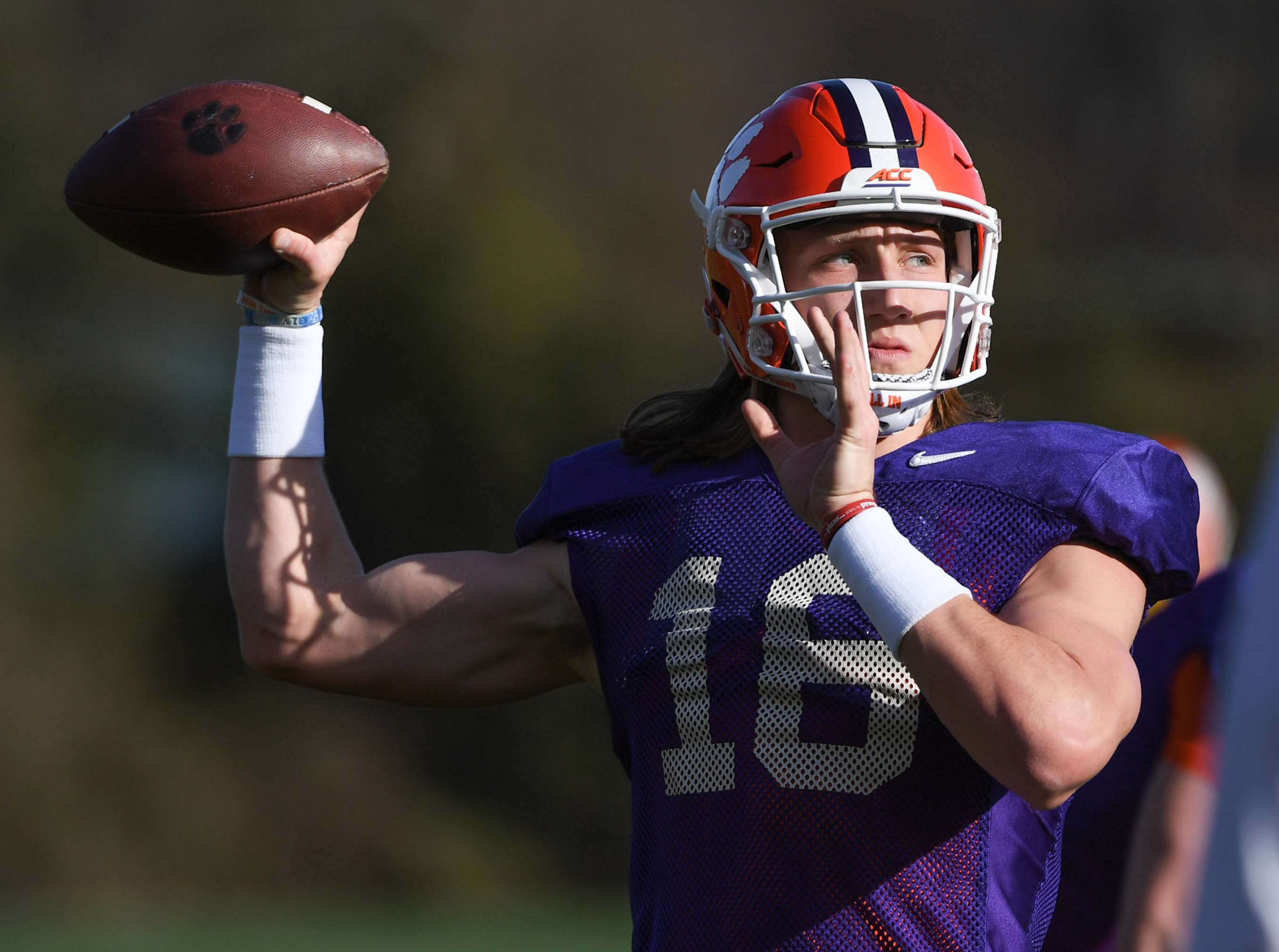 Clemson quarterback Trevor Lawrence (16) passes during practice at the Poe Indoor Facility in Clemson Monday.