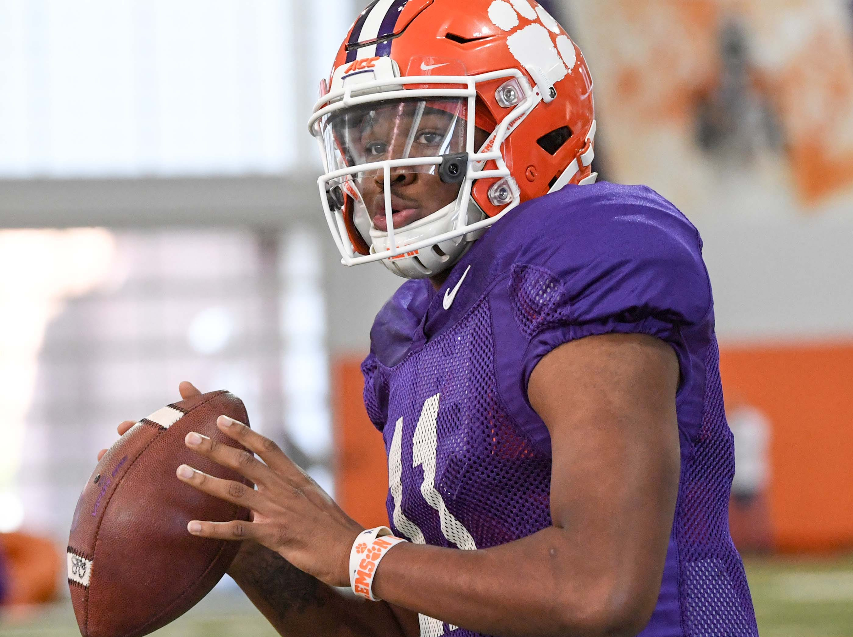 Clemson quarterback Taisun Phommachanh(11) fades back to pass during practice at the Poe Indoor Facility in Clemson Monday.