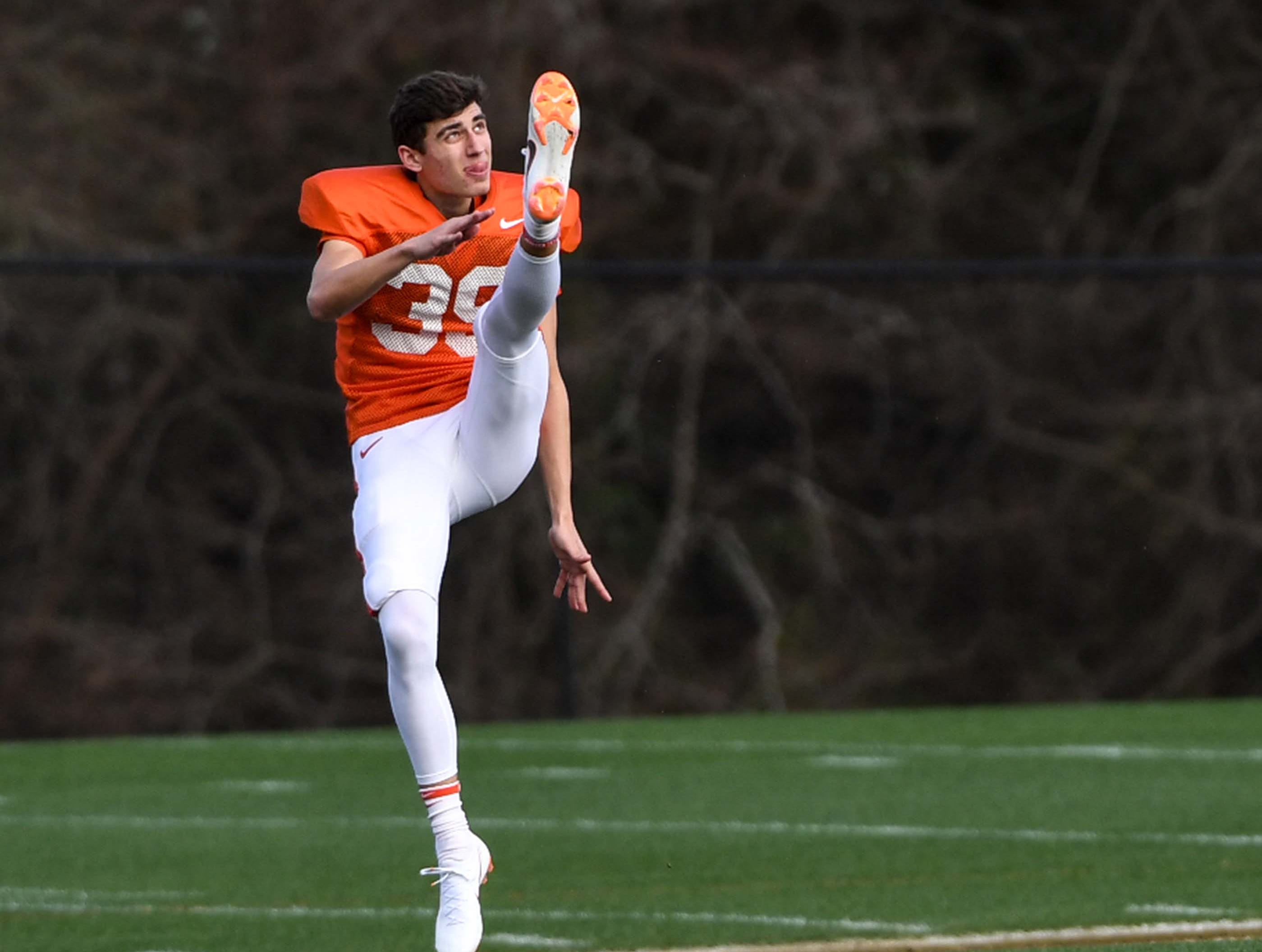 Clemson punter Aidan Swanson(39) punts during practice at the Poe Indoor Facility in Clemson Monday.