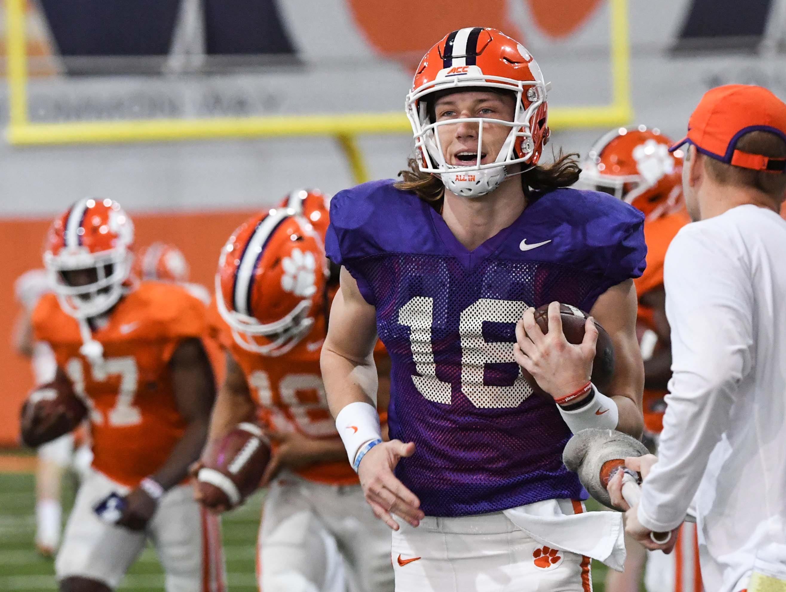 Clemson quarterback Trevor Lawrence (16) runs during practice at the Poe Indoor Facility in Clemson Monday.
