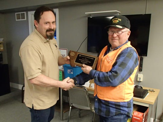 """Joe Yeoman being presented with his """"Instructor of the Year"""" plaque."""