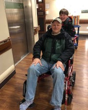 District Judge John Parker and Charlie, his 10-year-old son, are all smiles leaving Benefis Health System Sunday where Parker was treated for frostbite.