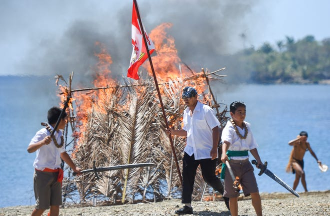 Local performers participate in a reenactment of Magellan's landing during the Guam History and Chamorro Heritage Day Festival 2019 at Umatac Bay Park, March 4, 2019.