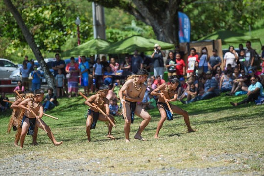 Local volunteers portraying ancient CHamorus, perform a dance in a reenactment of Magellan's landing, during the Guam History and Chamorro Heritage Day Festival 2019 at Umatac Bay Park, March 4, 2019.