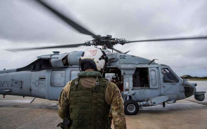 A U.S. Navy MH-60S Seahawk member, assigned to Helicopter Sea Combat Squadron 25, prepares to take off in this Feb. 20 file photo at Andersen Air Force Base. The squadron will conduct training from 11 a.m. to 11:55 p.m. June 25-27 at the Dandan-Malojloj training site in Inarajan.