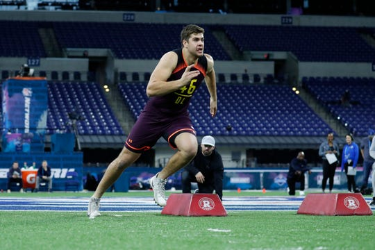 Iowa defensive lineman Anthony Nelson goes through workout drills during the 2019 NFL Combine at Lucas Oil Stadium.