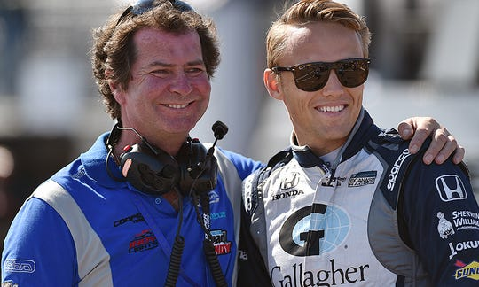 Team owner Trevor Carlin embraces Carlin Motorsports driver Max Chilton
