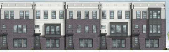 Renderings of townhouses  proposed at Fishers Station next to the Yard in Fishers.